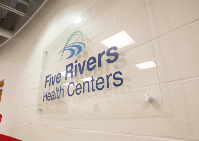 The Fiver River's Health Center sign within Roosevelt Elementary