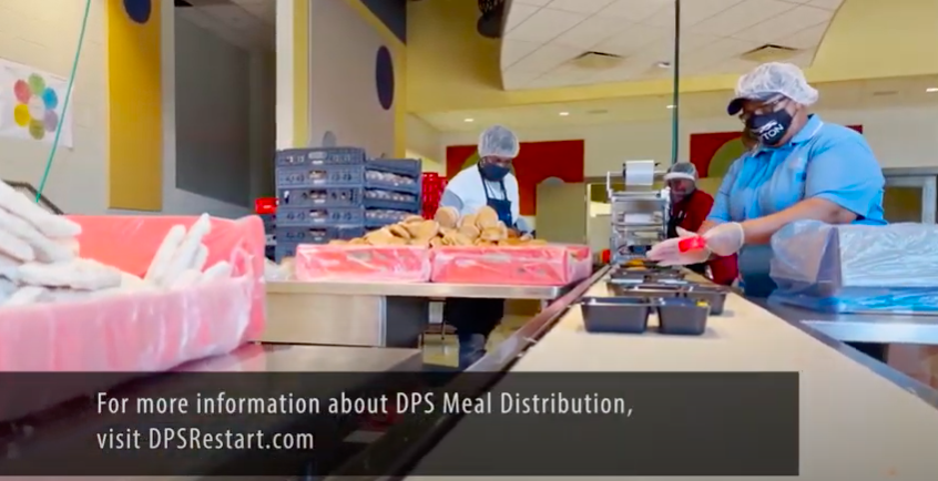 DPS Nutrition Services employees assemble meals in an assembly line.